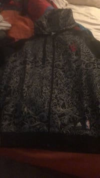 black and gray floral textile 550 km