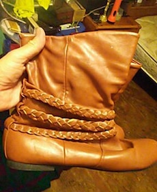 Women's pair of brown leather booties