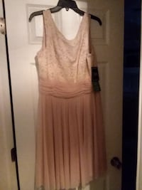 new with tags dress size 16 .