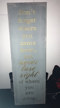 Black and brown wooden quote board
