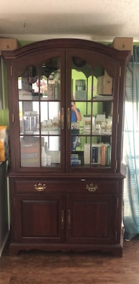 brown wooden framed glass display cabinet Summerville, 29486