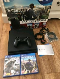 black Sony PS4 with DualShock 4 and game cases Manchester, M22
