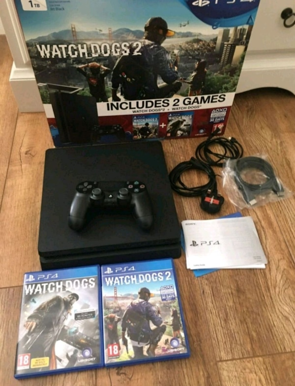 black Sony PS4 with DualShock 4 and game cases