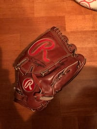 brown leather baseball mitt with text overlay Toronto, M5N 1C5