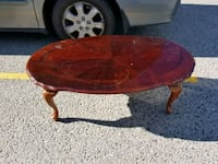 round brown wooden coffee table Kelowna, V1X 2C4