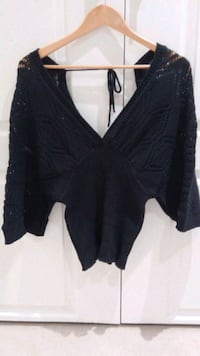 Knitted black top. Deep v neck back
