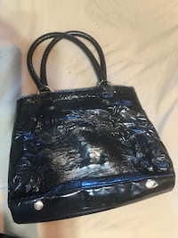 Black leather 2-way bag. My Pon Pon Secret. Fairly used but still good.  Montréal, H8R