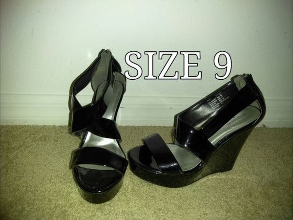 Pair of women's black wedge shoes size 9