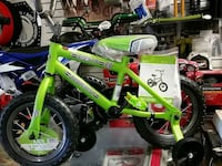 toddler's green bicycle with training wheels