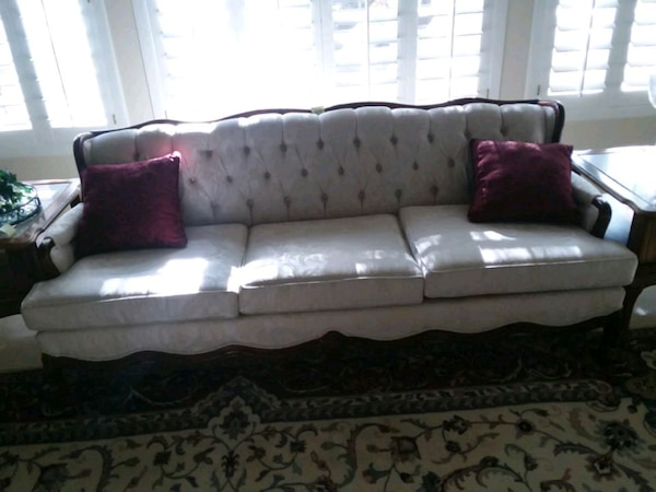 Used gray and pink floral fabric sofa for sale in Las Vegas - letgo