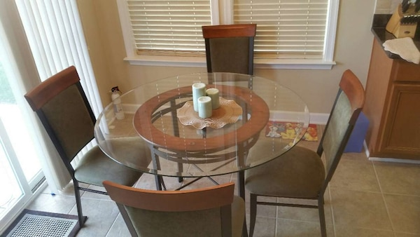 glass top round dining table with black iron frame