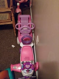 two pink ride-on toys