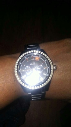 round silver and black chronograph watch with link bracelet