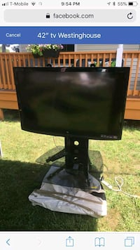 black flat screen TV with remote Uniondale, 11553