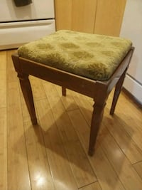 Old wooden padded sewing stool