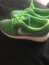 pair of green-and-white Nike running shoes Fayetteville, 28303