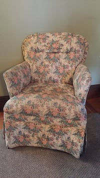 white, pink, and green flora fabric sofa chair