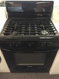 Refurbished good condition 5 burner gas stove with warranty  46 km