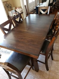 Solid Wood Dining table with 6 chairs and extensions