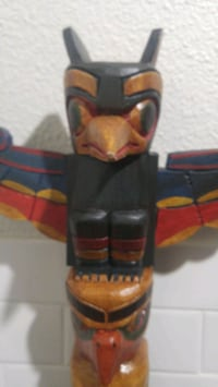 Hand carved native mini totem sets or singles .