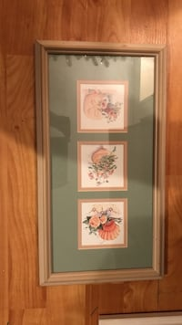 painting of flowers with brown wooden frame