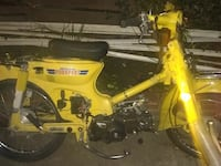 yellow pedal moped motorcycle