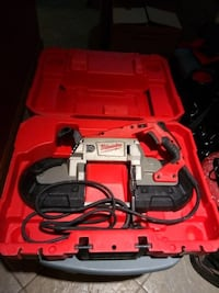 Red and black milwaukee power tool in case New York, 11212