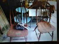 two brown wooden windsor chairs 336 mi