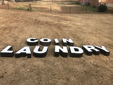 white and black coin laundry letter led signage