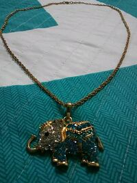 gold-colored and blue studded elephant pendant with chain necklace Leesburg, 20175