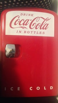 Red and white coca-cola ice cold compact refrigerator