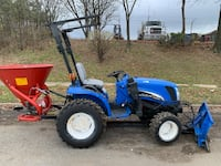 New holland Tractor with snow plow & salt spreader.