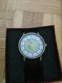round silver analog watch with black leather strap in box