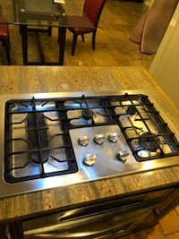 black and gray 4-burner gas stove null