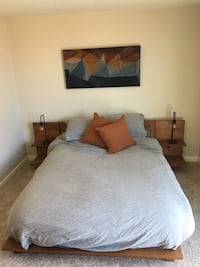 Brown wooden bed frame with white bed comforter Redondo Beach, 90277