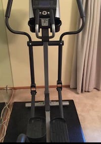 Life fitness Elliptical Machine Includes mat and iPad/tablet stand.