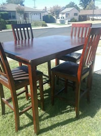 rectangular brown wooden table with four chairs dining set 2347 mi