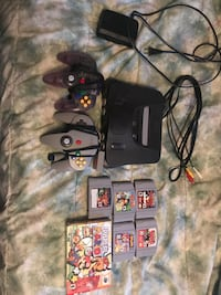 black Nintendo 64 console with controller and game cartridges Georgina, L4P 0A2