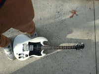 white and black electric guitar Annandale, 22003