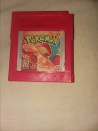 red and white Pokemon trading card