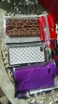 three brown, white, and purple smartphone protective cases