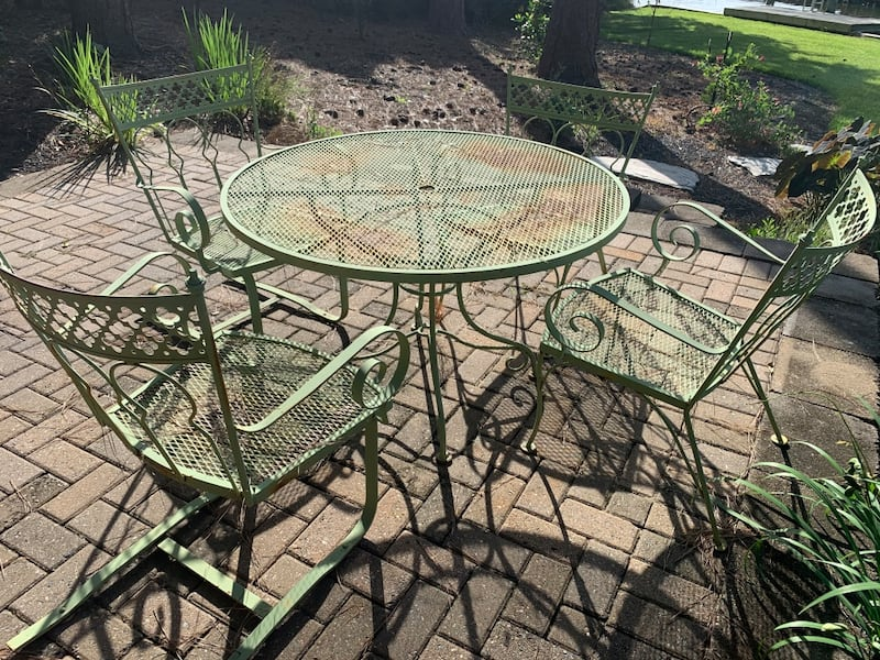 Vintage wrought iron patio outdoor table n 4 chairs 50+ yrs old. 820566cb-49cc-44ff-a89c-6e7c8624c32b