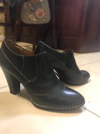 pair of black leather round toe chunky heeled booties Ringgold