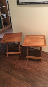 two square teal outdoor foldable side tables