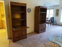 two brown wooden hutch shelves