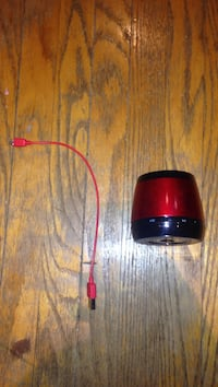 red and black bluetooth speaker