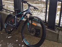Black and blue front-suspension bike Edmonton, T5H 3V5