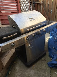 Gray four-burner Char-Broil gas grill with side-burner