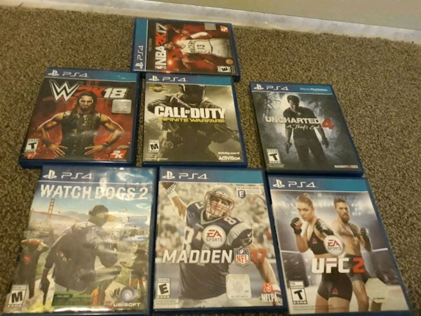 eight assorted PS4 game cases