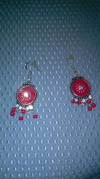 pair of red-and-gold earrings 292 mi